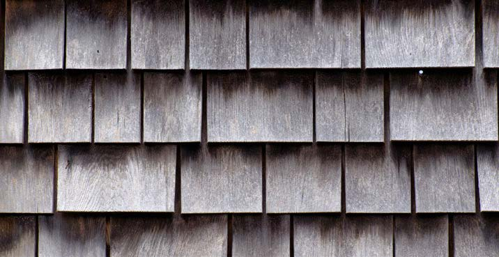 Close up of cedar wood shingle siding