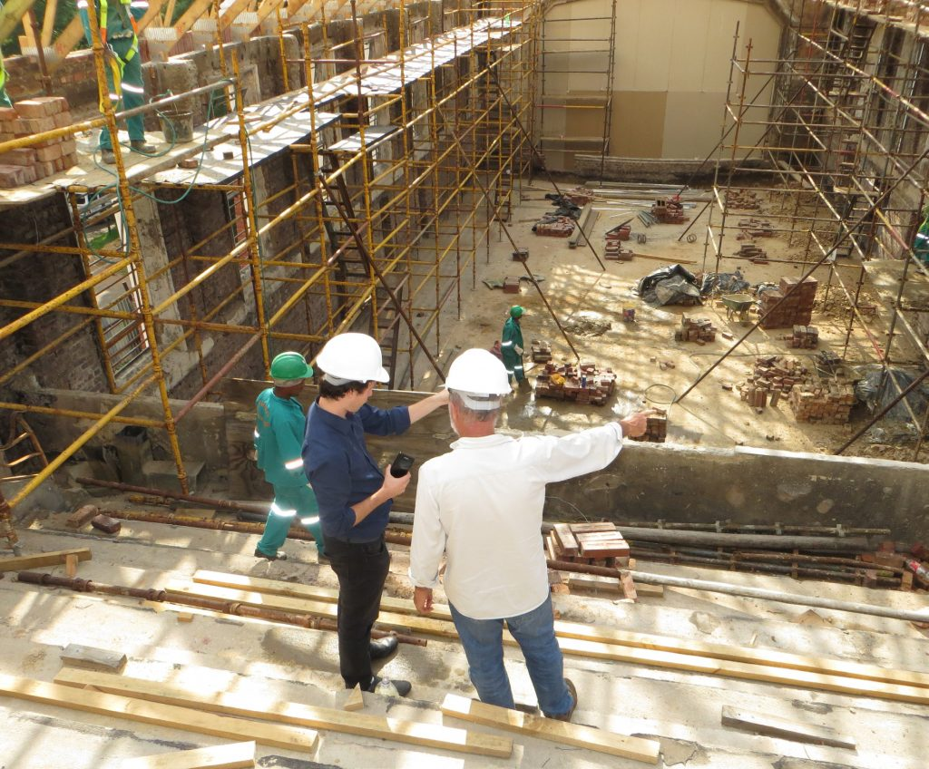 Construction workers on site at a building under construction