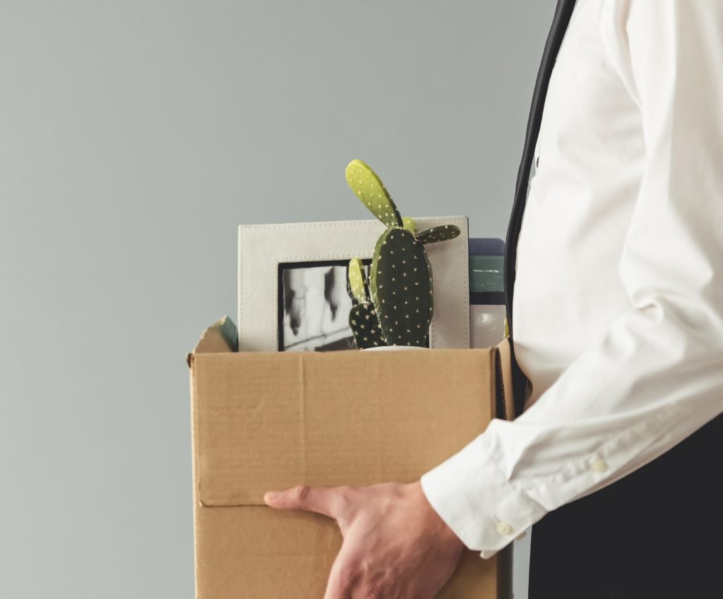 Person holding a box with their personally belongings