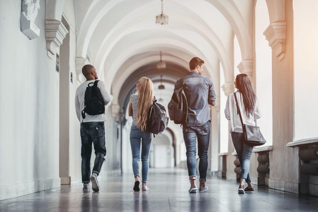 College students walking down hallway