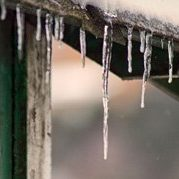 Icicles hanging off a rooftop in winter
