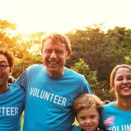 Volunteers arm in arm
