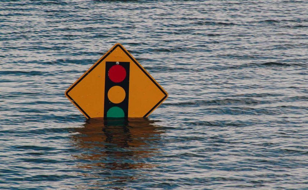 Flooding area with a traffic sign partially under water
